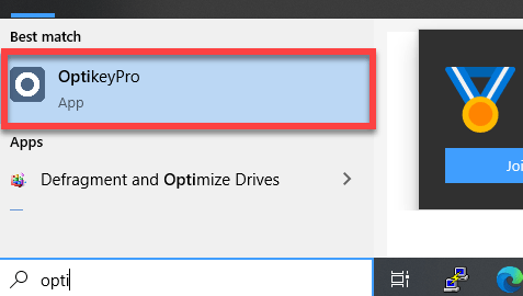 La imagen muestra el programa OptiKeyPro en la barra de busqueda de Windows